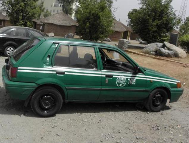 Green Taxis Abuja A car painted in the Nigerian National